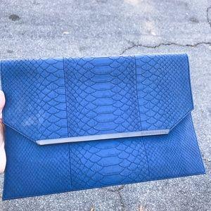 Bcbg royal blue snake print clutch